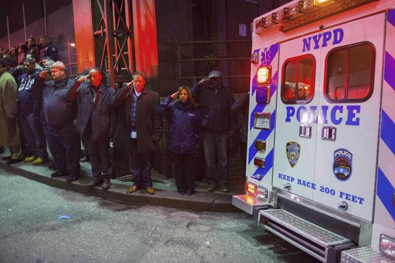 Individuals Saluting the Two NYC Police Department Who Were Shot and Killed
