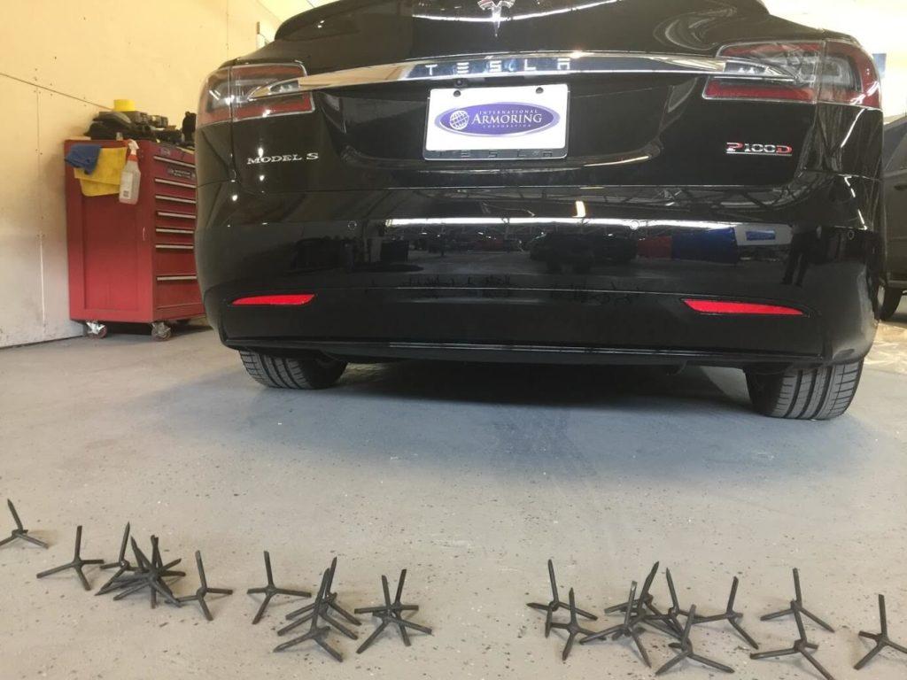 Tacks behind Tesla from Armormax