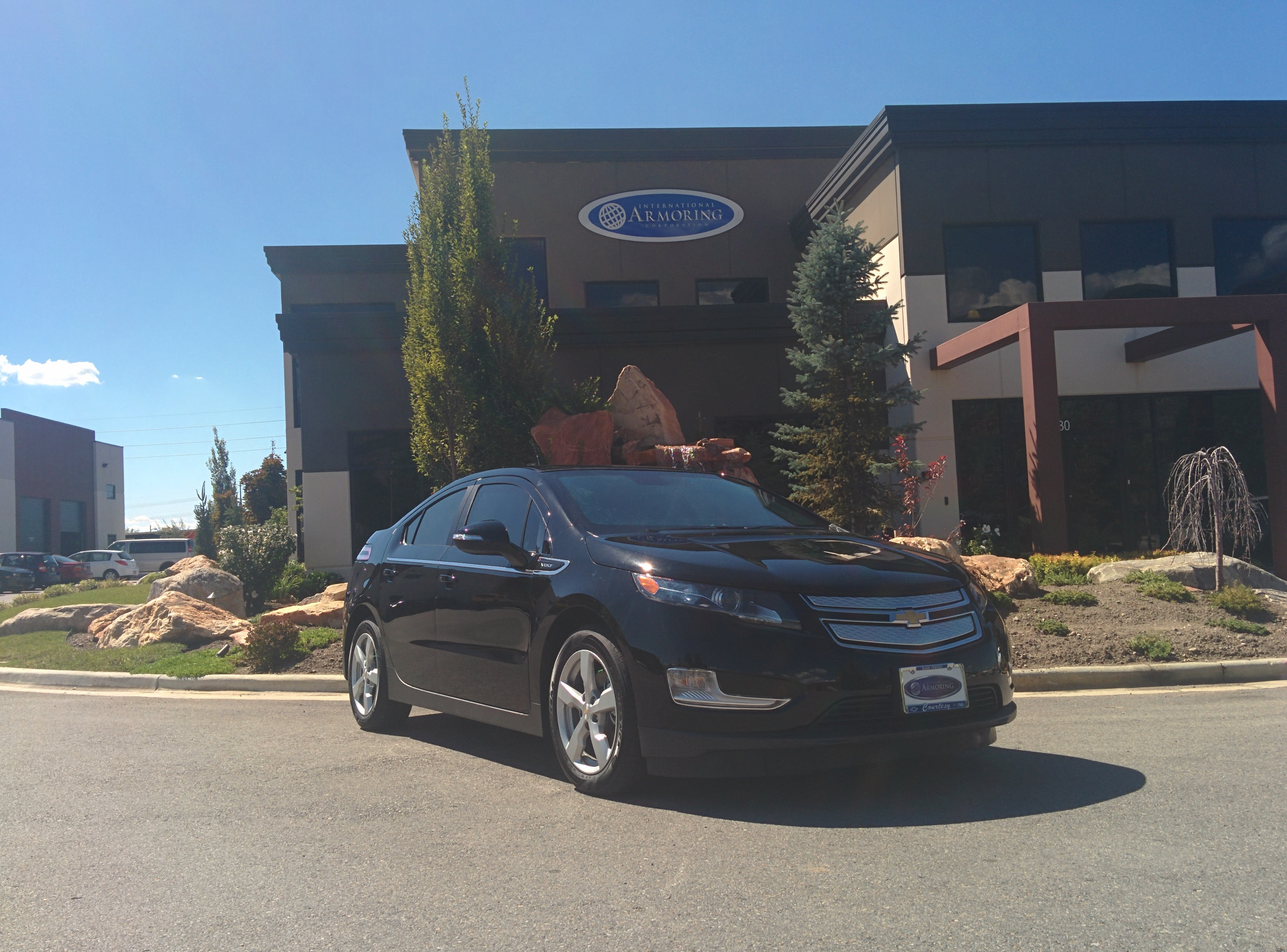 Bulletproof Chevy Volt in front of Armormax Utah facility
