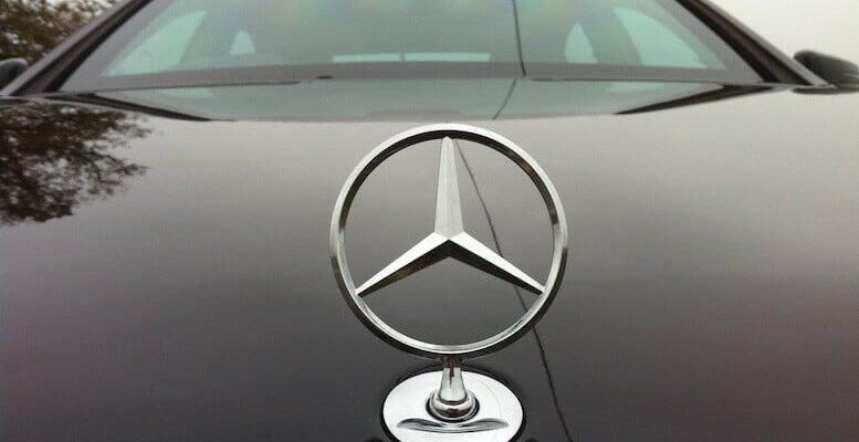 front of a Bulletproof Mercedes-Benz S500 Series