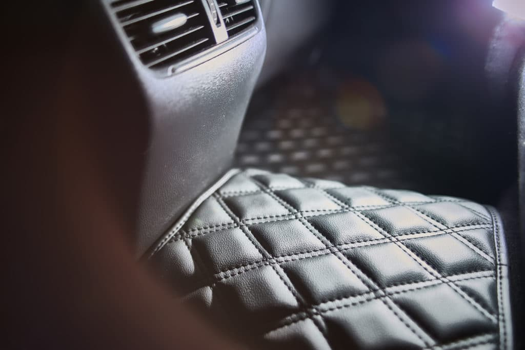 luxury leather floor mat modern car interior second row close up