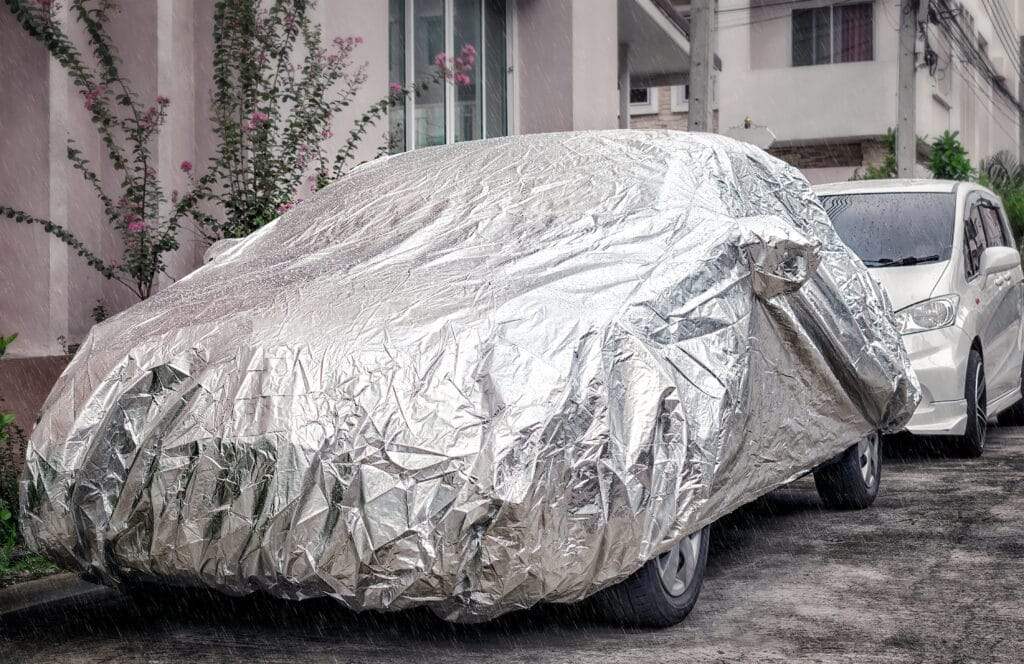 Weather Proof Car Cover Protects Vehicle from Rain.